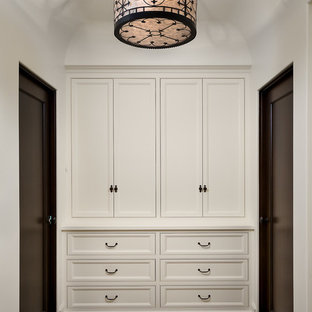 Dressing room - traditional gender-neutral dark wood floor dressing room idea in Los Angeles with recessed-panel cabinets and white cabinets