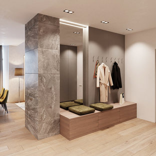 This is an example of a mid-sized contemporary gender-neutral dressing room in Other with open cabinets, grey cabinets, bamboo floors and beige floor.