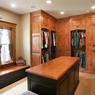 Inspiration for a rustic closet remodel in Cleveland with medium tone wood cabinets