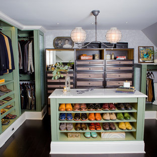 This is an example of a large traditional men's walk-in wardrobe in Other with open cabinets, green cabinets, bamboo floors and brown floor.