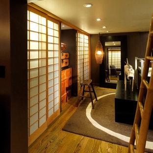 Example of a zen reach-in closet design in San Francisco