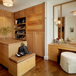 This is an example of a large transitional women's dressing room in San Francisco with medium wood cabinets, dark hardwood floors, shaker cabinets and brown floor.