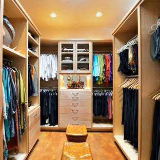 Walk-in closet - large transitional gender-neutral concrete floor walk-in closet idea in Dallas with flat-panel cabinets and light wood cabinets
