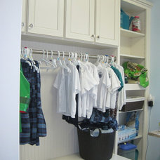 Traditional Closet by Singer Kitchens
