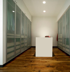 modern closet by the construction zone, ltd.