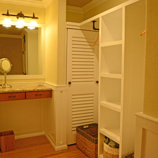 Design ideas for a mid-sized traditional gender-neutral dressing room in Hawaii with open cabinets, white cabinets and bamboo floors.