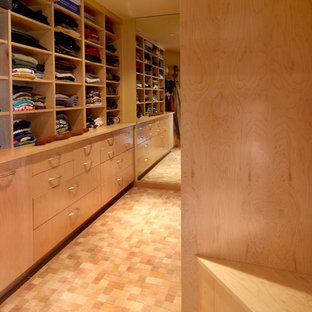 Dressing room - contemporary carpeted dressing room idea in San Francisco with light wood cabinets