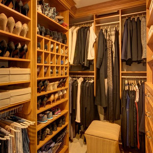 This is an example of a mid-sized traditional gender-neutral walk-in wardrobe in New York with open cabinets, light wood cabinets, carpet and beige floor.