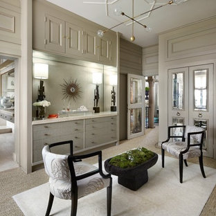 This is an example of a large transitional gender-neutral dressing room in Chicago with grey cabinets, carpet and flat-panel cabinets.