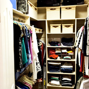 Small elegant gender-neutral carpeted walk-in closet photo in Boise with open cabinets and white cabinets