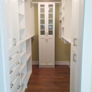Small Walk-in closet in White finish and Shakers doors
