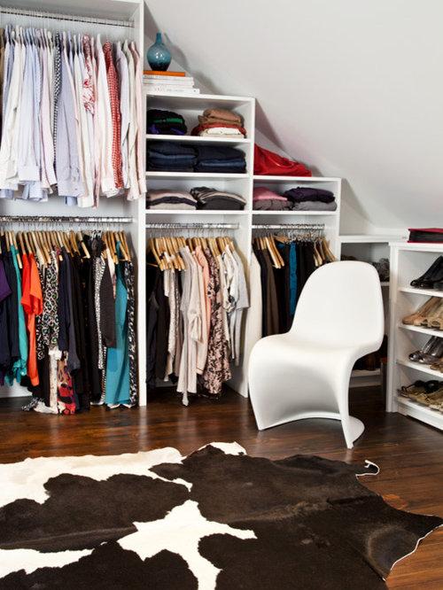 Example Of A Large Trendy Womenu0027s Dark Wood Floor Walk In Closet Design In  Toronto