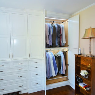 Example of a mid-sized transitional men's dark wood floor dressing room design in New York with raised-panel cabinets and white cabinets