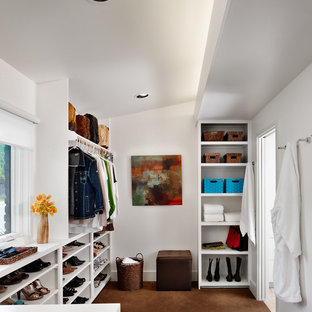 Minimalist carpeted dressing room photo in Austin with open cabinets and white cabinets