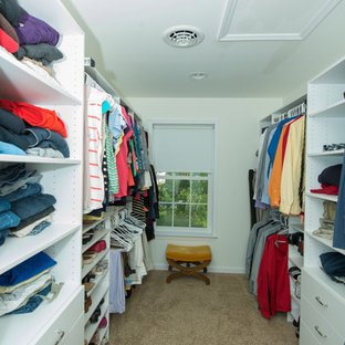 Mid-sized elegant gender-neutral carpeted walk-in closet photo in Philadelphia with flat-panel cabinets and white cabinets