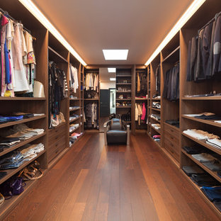 Large trendy gender-neutral medium tone wood floor and brown floor dressing room photo in Los Angeles with flat-panel cabinets and medium tone wood cabinets