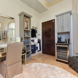 This is an example of an expansive transitional women's dressing room in Sacramento with open cabinets, grey cabinets, limestone floors and beige floor.