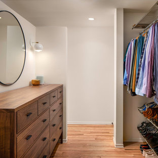 Inspiration for a midcentury gender-neutral dressing room in Portland with light hardwood floors.