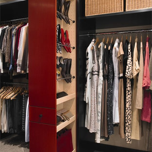 Large trendy gender-neutral carpeted and beige floor walk-in closet photo in Houston with flat-panel cabinets and red cabinets