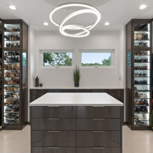 Inspiration for a mid-sized contemporary gender-neutral walk-in wardrobe in Tampa with flat-panel cabinets, dark wood cabinets, light hardwood floors and beige floor.