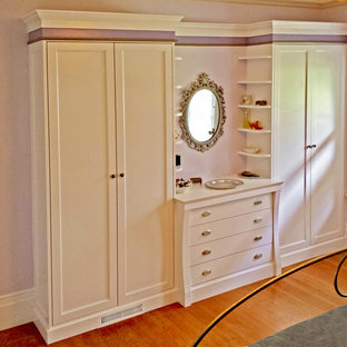 Large traditional women's dressing room in San Francisco with recessed-panel cabinets and white cabinets.