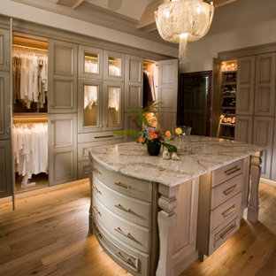 Dressing room - large traditional gender-neutral medium tone wood floor and brown floor dressing room idea in Wichita with recessed-panel cabinets and beige cabinets