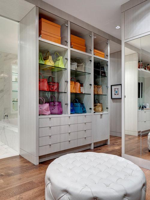 Example Of A Trendy Medium Tone Wood Floor Walk In Closet Design In Dallas  With