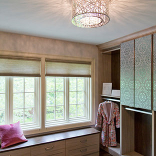 Dressing room - large transitional gender-neutral dark wood floor and brown floor dressing room idea in Kansas City with flat-panel cabinets and light wood cabinets