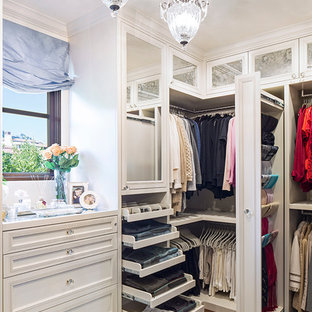 Inspiration for a timeless closet remodel in Los Angeles with white cabinets