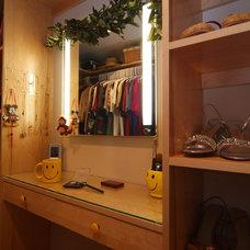 Contemporary Closet by The Grand Design