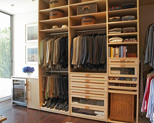 Example Of A Trendy Walk In Closet Design In Los Angeles