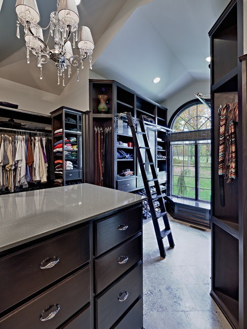 Example Of A Classic Walk In Closet Design In Cleveland With Dark Wood  Cabinets
