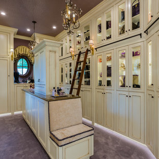 Tuscan women's carpeted and purple floor dressing room photo in Other with beaded inset cabinets and beige cabinets