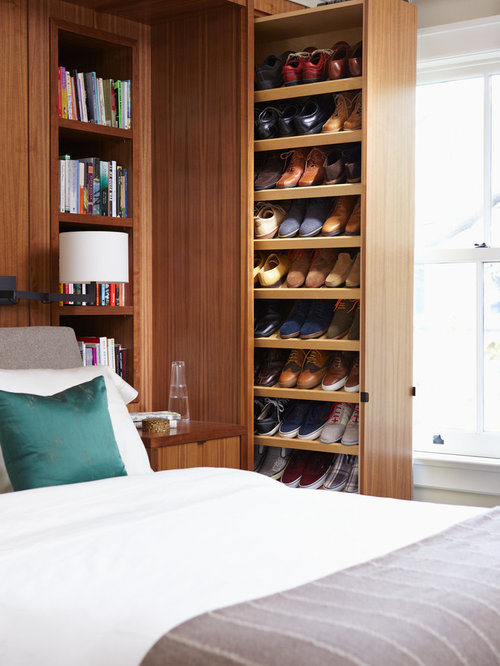 Inspiration For A Contemporary Reach In Closet Remodel In Toronto With  Flat Panel Cabinets