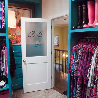 Inspiration for a small eclectic women's carpeted dressing room remodel in Charleston with blue cabinets