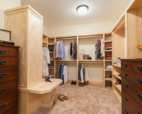 Example Of A Classic Walk In Closet Design In Other