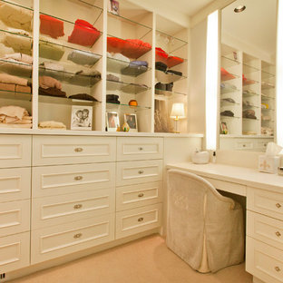 Dressing room - traditional women's dressing room idea in Omaha with white cabinets and recessed-panel cabinets