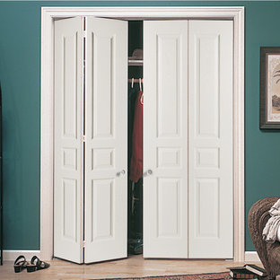 Closet - small traditional light wood floor closet idea in Orange County with white cabinets