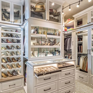 Elegant women's carpeted and gray floor walk-in closet photo in Miami with raised-panel cabinets and white cabinets