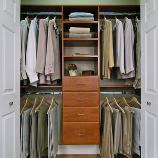 Photo of a mid-sized traditional gender-neutral built-in wardrobe in Burlington with open cabinets, brown floor and laminate floors.