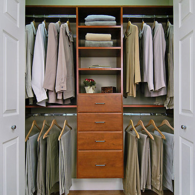 Example of a mid-sized classic gender-neutral brown floor and laminate floor reach-in closet design in Burlington with open cabinets