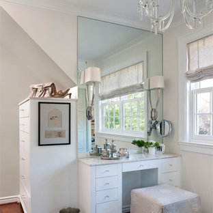 Inspiration for a timeless women's dressing room remodel in Detroit with white cabinets