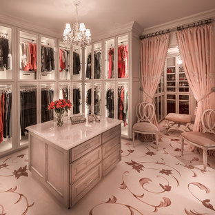 Dressing room - traditional women's carpeted dressing room idea in Houston with glass-front cabinets and white cabinets