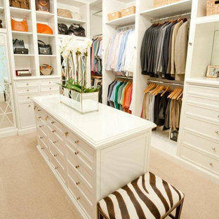Inspiration for a traditional walk-in wardrobe in Houston with white cabinets.