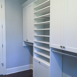 Inspiration for a large transitional gender-neutral dark wood floor and brown floor walk-in closet remodel in Atlanta with shaker cabinets and white cabinets