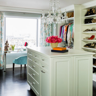 Example of a transitional women's dark wood floor dressing room design in Boston with open cabinets