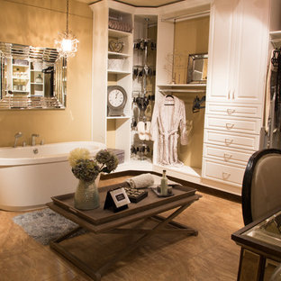 Photo of an expansive shabby-chic style dressing room for women in Phoenix with open cabinets, white cabinets and travertine flooring.
