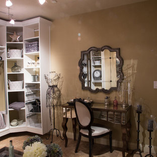 Design ideas for an expansive shabby-chic style dressing room for women in Phoenix with open cabinets, white cabinets and travertine flooring.