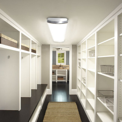 Walk-in closet - contemporary dark wood floor walk-in closet idea in Minneapolis with open cabinets and white cabinets