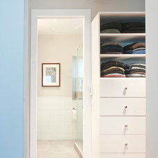 Contemporary Closet by Impact Remodeling and Construction